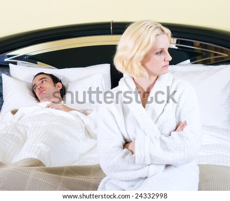young couple having a fight in the bedroom - stock photo