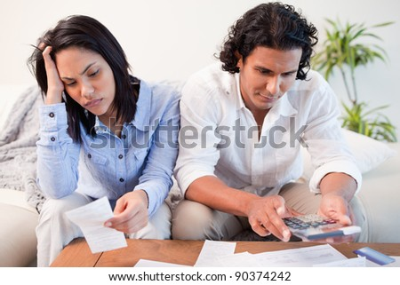 Young couple having a hard time doing their finances - stock photo