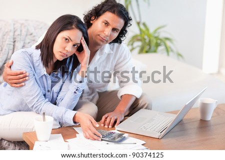 Young couple having a hard time paying their bills - stock photo
