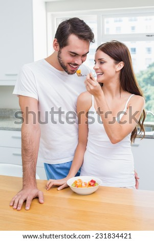 Young couple having a healthy breakfast at home in the kitchen - stock photo