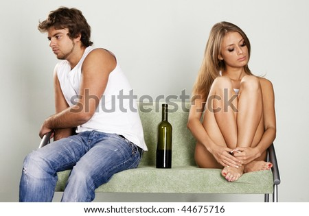 Young couple having a quarrel at home - stock photo