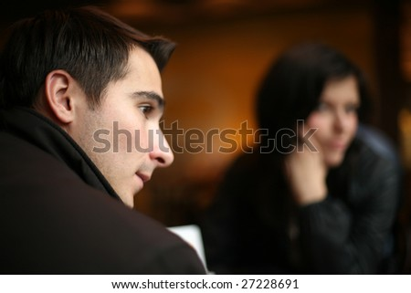 Young couple having a silent moment together. Shallow DOF. - stock photo