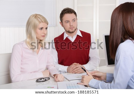 Young couple having an appointment at bank or insurance.