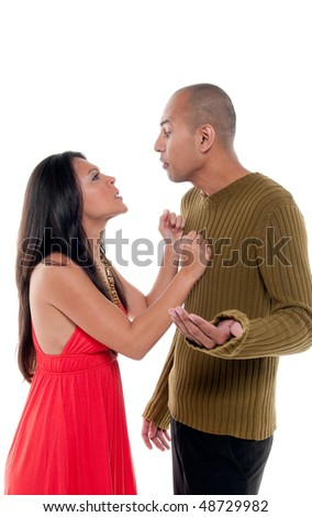Young couple having an argue very stressed and fighting. - stock photo