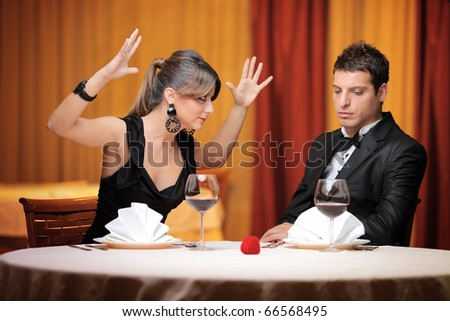 Young couple having an argument in a restaurant - stock photo