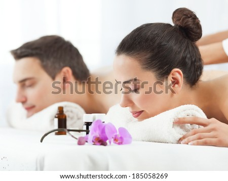 Young couple having aromatherapy massage in a spa. - stock photo