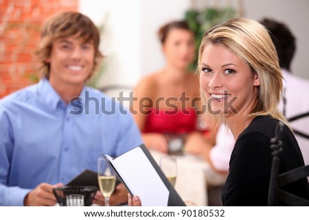 Young couple having dinner in a restaurant - stock photo