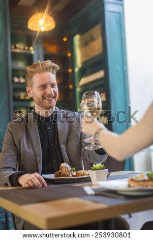 Young couple having dinner in the restaurant - stock photo