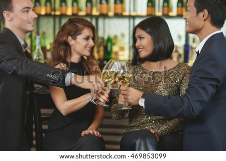 Young couple having double date in restaurant