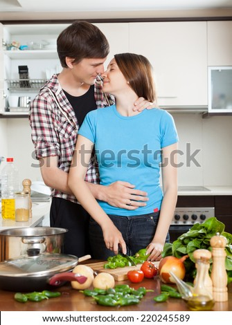 Young couple having flirt at domestic kitchen