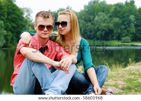 Young couple having fun at riverside