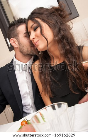 Young couple having fun at the restaurant.  - stock photo