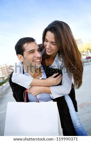 Young couple having fun doing shopping - stock photo