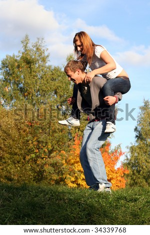 Young couple having fun in the park - stock photo