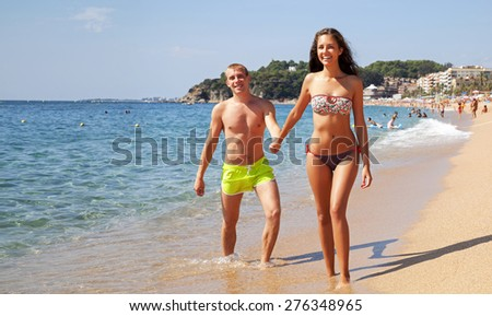 Young couple having fun on the seaside. - stock photo