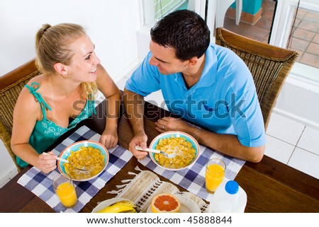 young couple having healthy breakfast together - stock photo