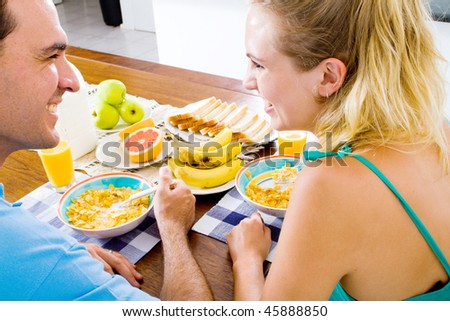 young couple having healthy breakfast together