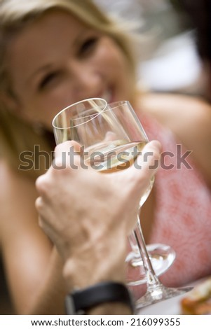 Young couple having meal in restaurant - stock photo