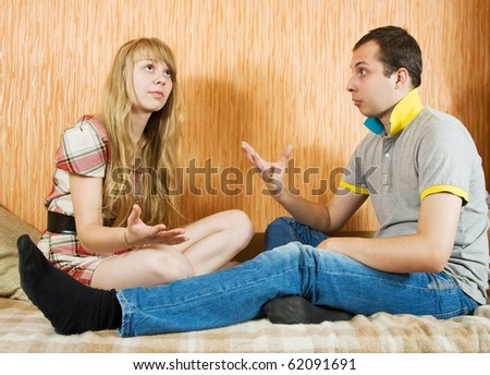 young couple having quarrel at home interior - stock photo
