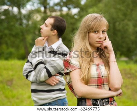 young couple having quarrel. Focus on girl only - stock photo