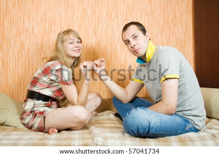 young couple having reconciliation  in the bedroom - stock photo