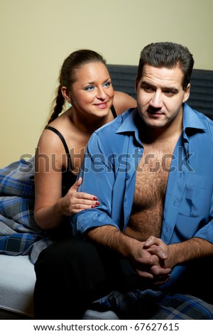 Young couple having relationship problems, in bedroom