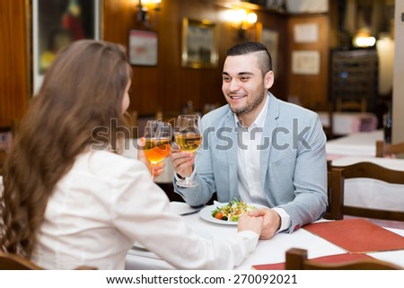 Young couple having romantic dinner with champagne in restaurant  - stock photo