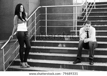 Young couple having some problems - stock photo