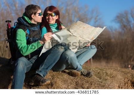 Young couple hiking with backpacks.
