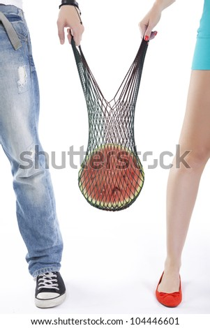 Young couple holding a bag with food isolated over white background - stock photo