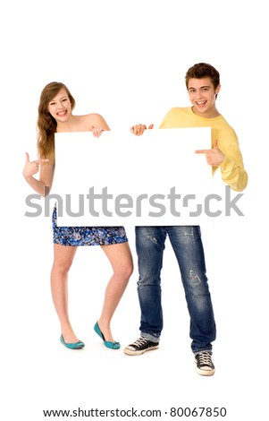 Young couple holding blank poster - stock photo