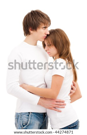 Young couple holding each other with sadness - stock photo