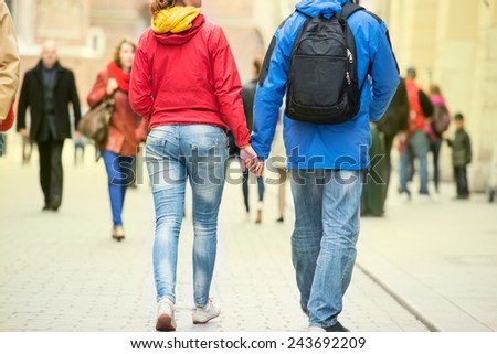 Young couple holding hands on the street