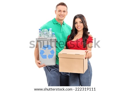 Young couple holding recycle bin and a box isolated on white background - stock photo
