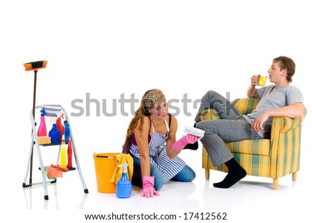 Young couple, housewife attending to household, lazy husband in sofa with beer.  Studio, white background