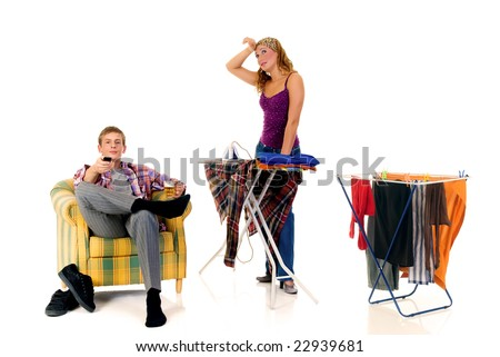 Young couple, housewife attending to household, lazy husband in sofa with beer.  Studio, white background - stock photo