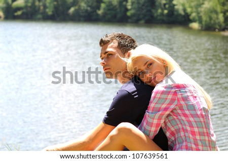 Young couple hug at lake