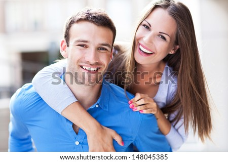 Young couple hugging. Young Couple Hugging Stock Images  Royalty Free Images   Vectors
