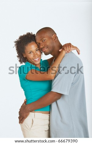 Young couple hugging and smiling for the camera