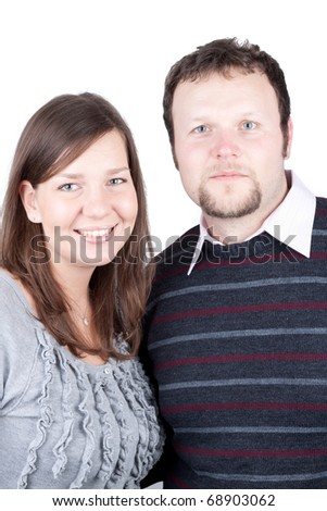 Young couple hugging each other against white background