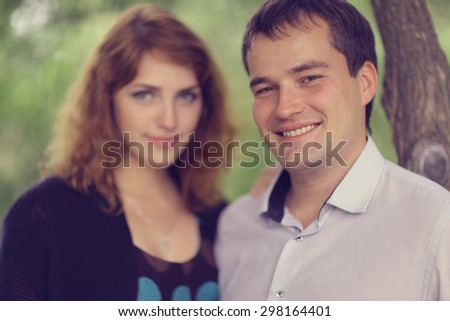 Young couple hugging in the park summer