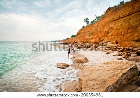 young couple hugging near the sea shore...