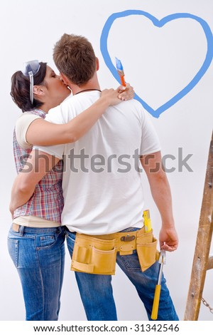 Young couple improving new home. - stock photo