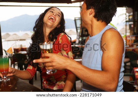 Young couple in a bar - stock photo