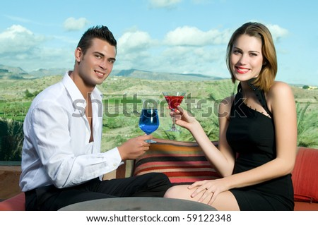 young couple in a bar laughing - stock photo