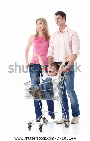 Young couple in a cart driven by his son on a white background - stock photo
