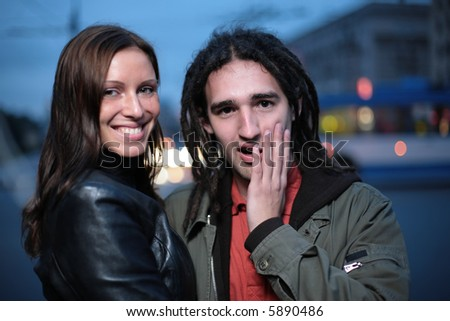 Young couple in a city - stock photo