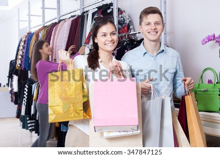 Young couple in a clothing store with shopping bags