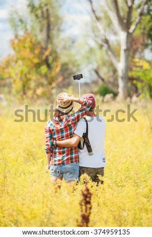 young couple in a field makes selfie