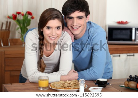 Young couple in a kitchen - stock photo